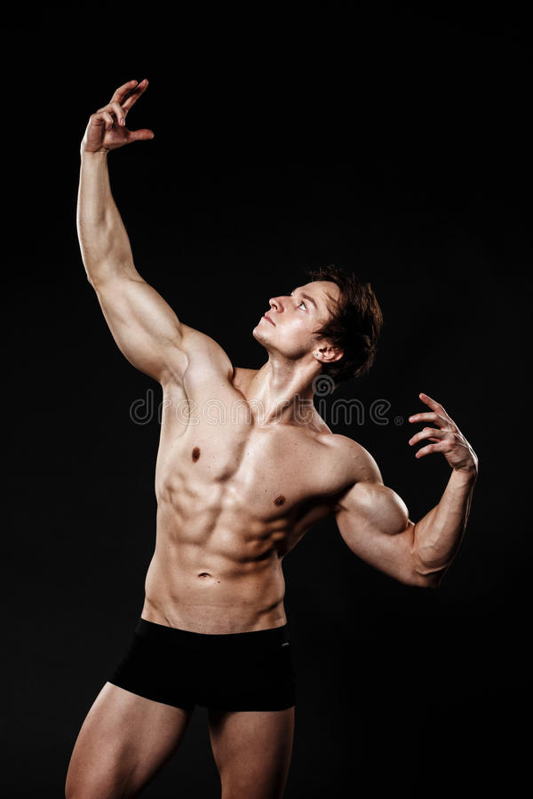 Handsome athletic man. Strong bodybuilder with six pack, perfect royalty free stock photo