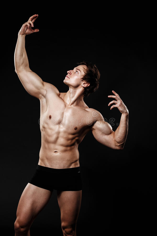 Handsome athletic man. Strong bodybuilder with six pack, perfect royalty free stock photography