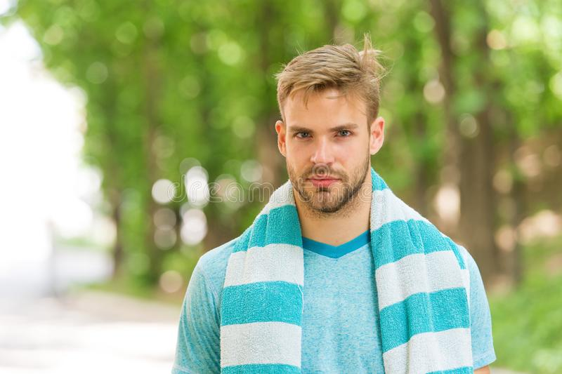 Handsome and athletic. Handsome man in summer style on summer day. Caucasian guy with sexy beard on handsome face and royalty free stock images