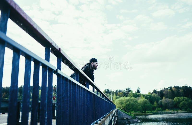 Model man on bridge. Handsome attractive bearded model man on bridge royalty free stock photos