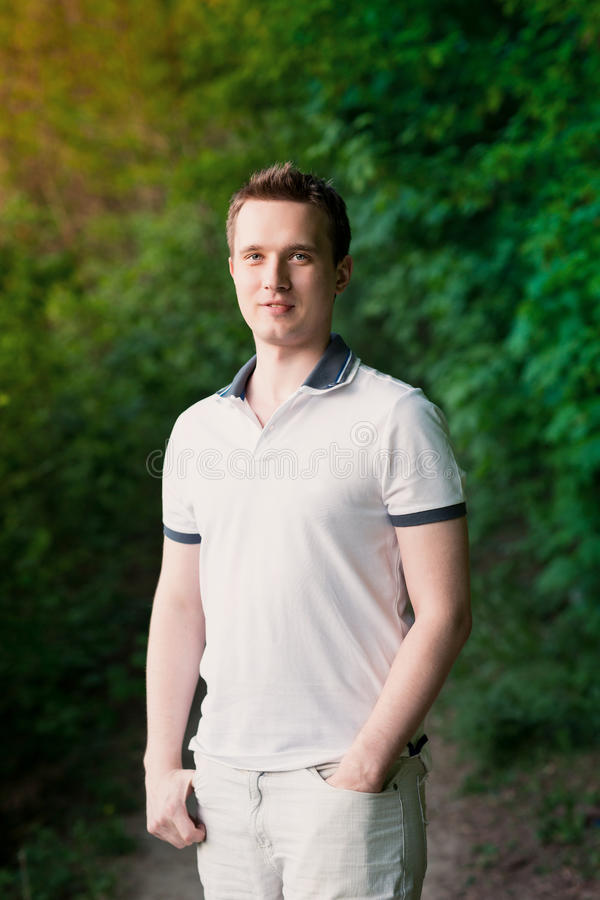 Free Handsome Attractive Young Man Standing In The Park Royalty Free Stock Photos - 30893648