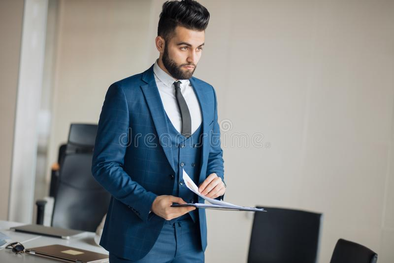 Handsome awesome businessman with folder royalty free stock images