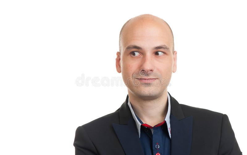 Handsome bald man looking to copy space stock photography