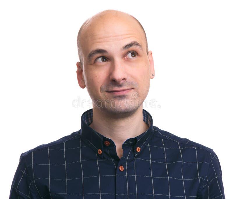 Handsome bald man thinking stock photo