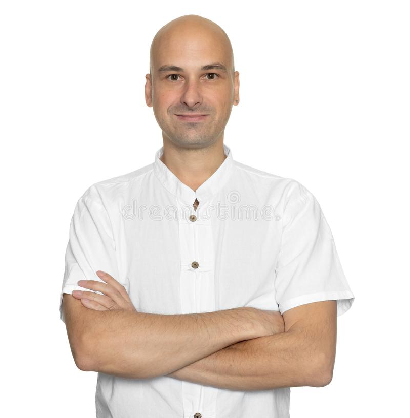 Handsome bald man wearing casual white shirt stock photos