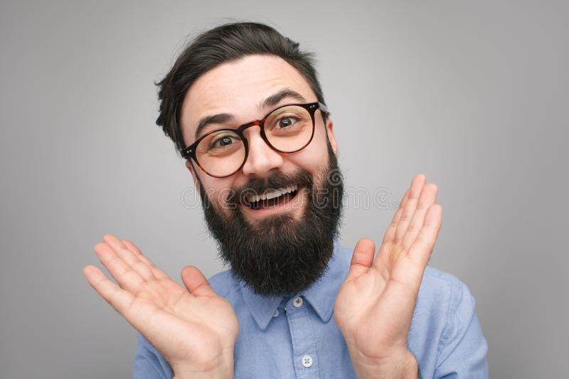Handsome bearded hipster looking happy royalty free stock photo