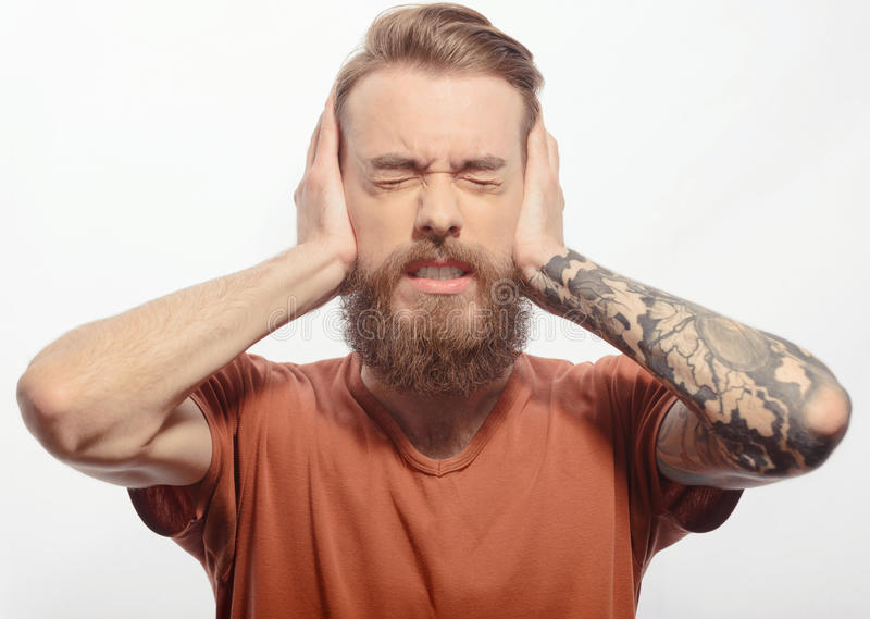 Handsome bearded man with headache stock images
