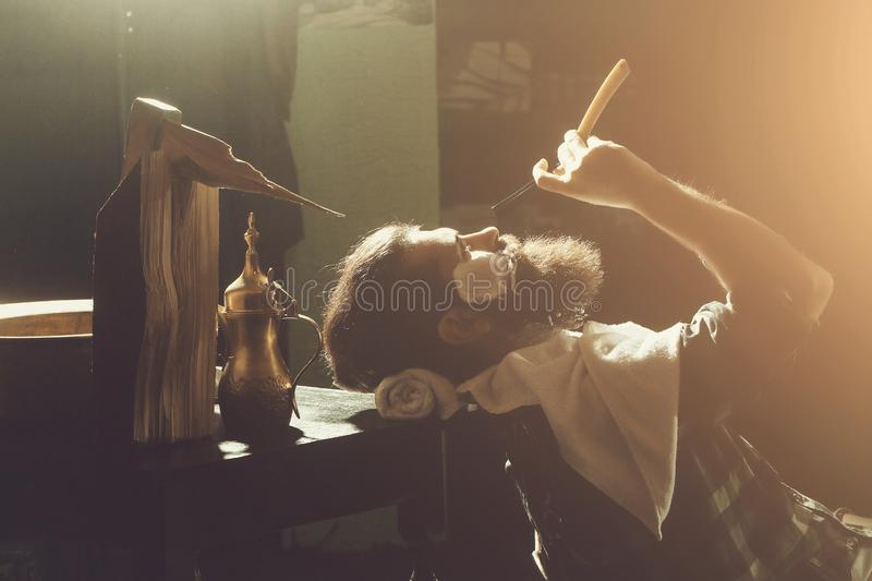 Bearded man with beard shaves stock image