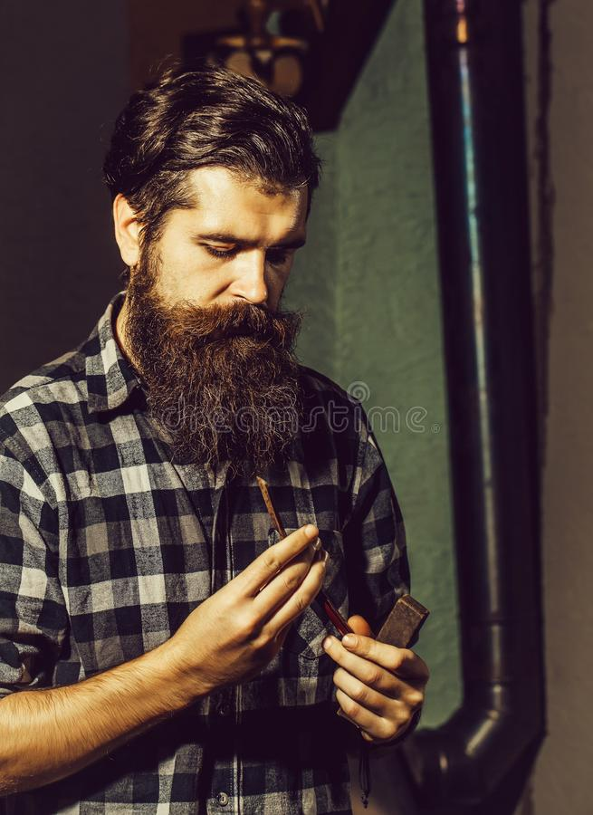 Bearded barber man with razor royalty free stock photo