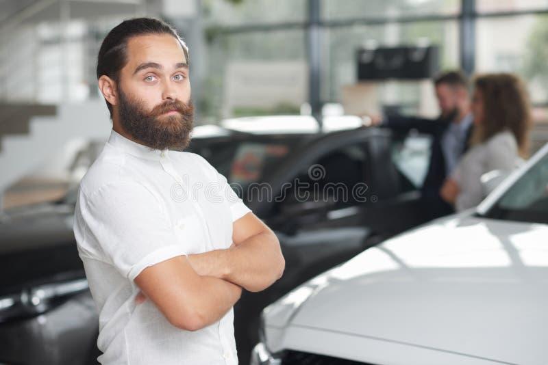 Handsome customer of car dealership posing. royalty free stock photo