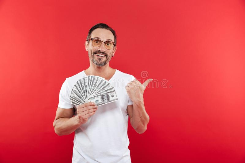 Handsome bearded man 30s in casual white t-shirt wearing glasses stock photo
