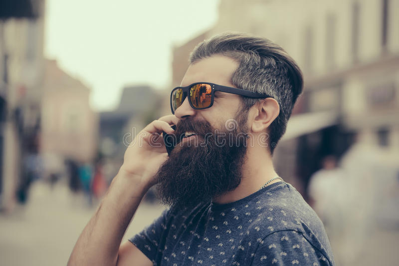 Handsome bearded man in sun glasses stock photo