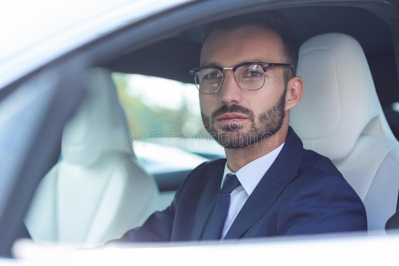 Handsome bearded man wearing glasses sitting in car stock photos