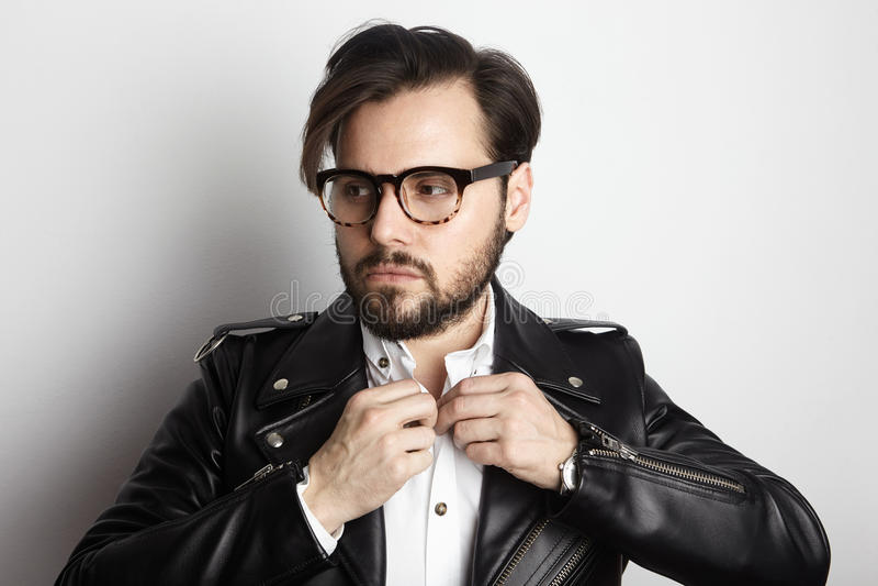Handsome Bearded Man Wearing Stylish Shirt Black Leather Jacket.Beauty,Lifestyle,People Concept Photo.Adult Serious. Hipster Guy Empty White Background stock photo