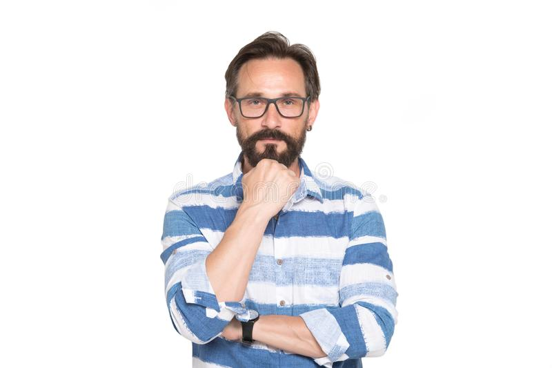 Portrait of thoughtful bearded man with fist under his chin. Handsome bearded mature man wearing glasses and looking at you with thoughtful expression on his stock image