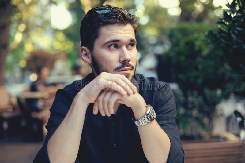 Handsome big moustache hipster man in the city cafe royalty free stock photos