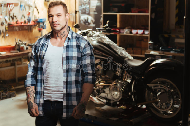 Handsome biker being circled with tools stock photography