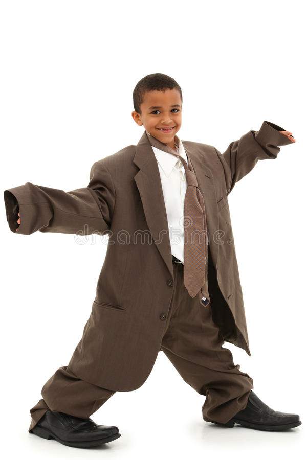 Handsome Black Boy Child in Baggy Business Suit. Adorable Handsome Black Boy Child in Baggy Business Suit laughing and walking over white background stock images