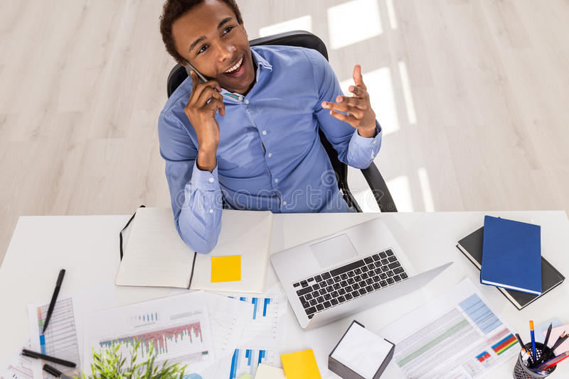 Handsome black businessman on phone royalty free stock image
