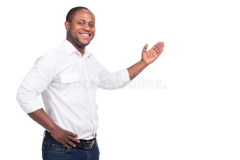 Handsome black man standing and smiling. royalty free stock photos