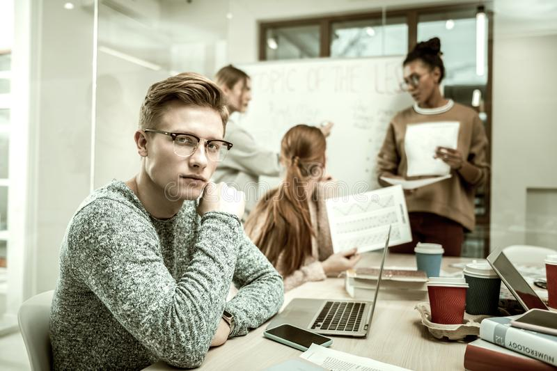 Handsome blonde-haired student taking part in study group stock image