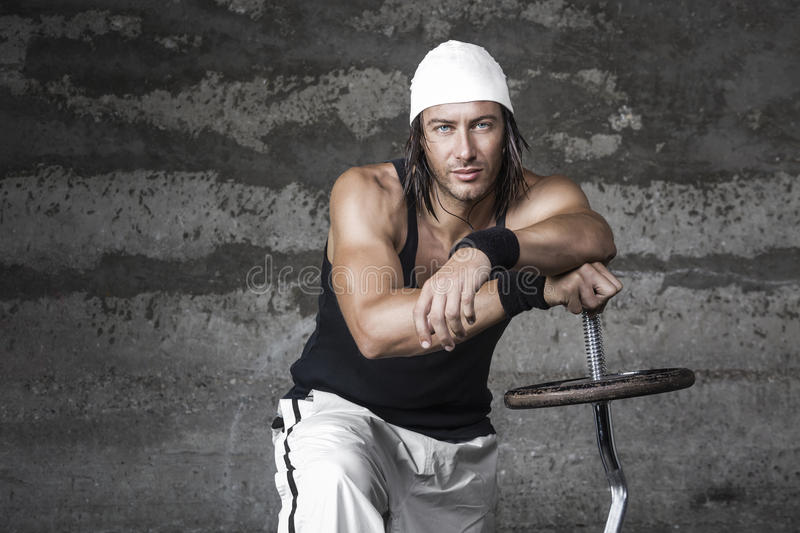 Handsome blue eyes athletic man. Posing in front of the camera royalty free stock images