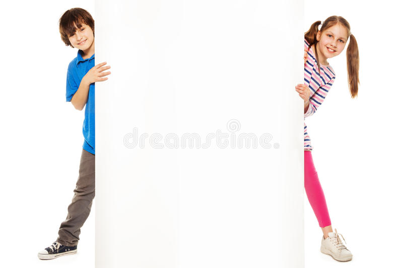 Two kids showing new blank advertising royalty free stock images