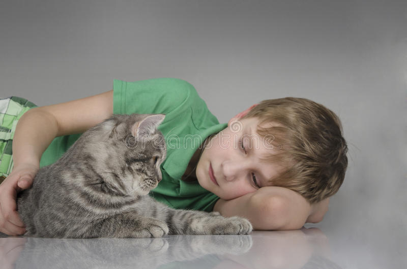Handsome boy with a cute cat stock photos