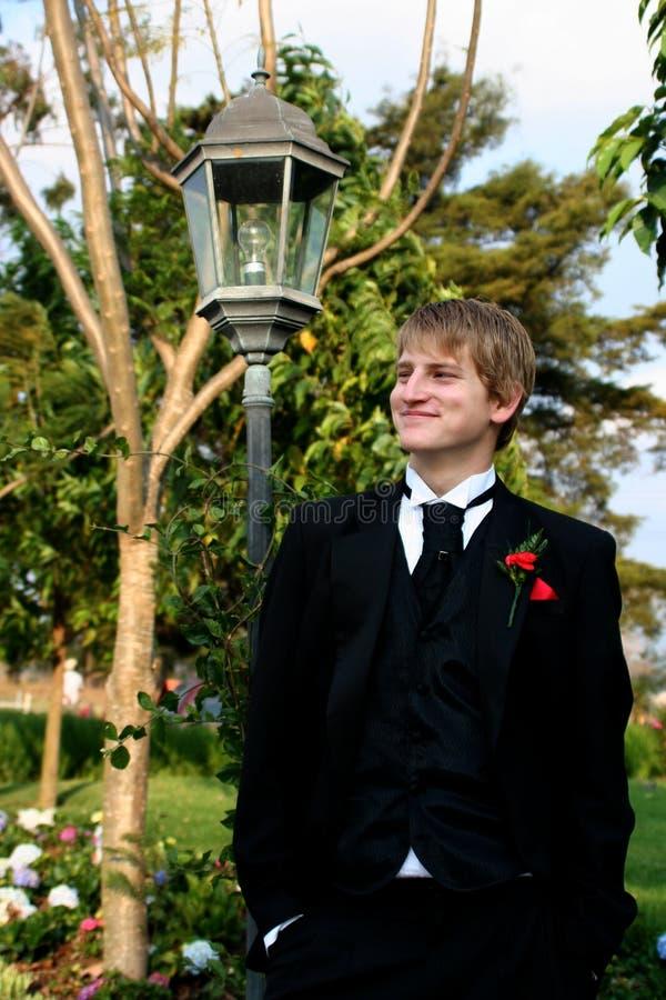 Handsome Boy Dressed In Formal Attire Stock Photo