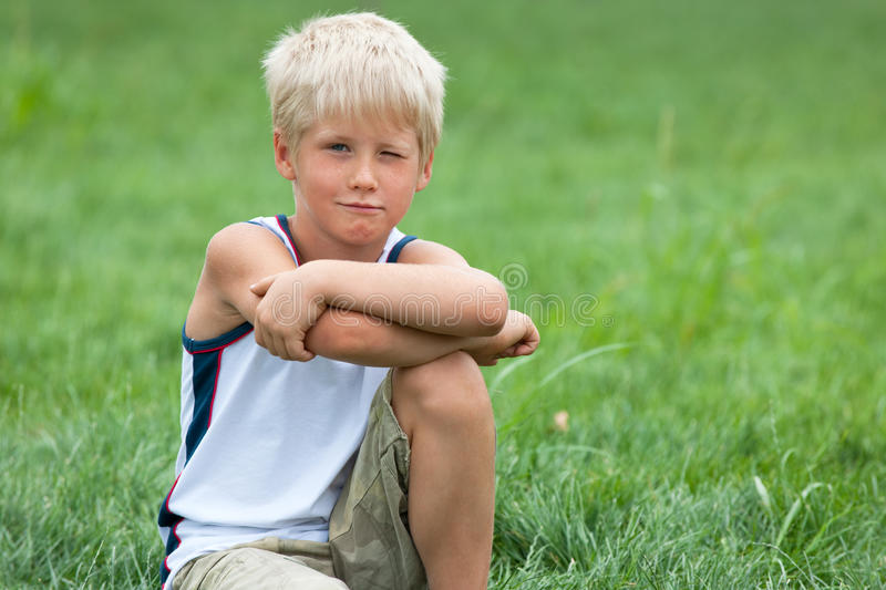 Download Handsome Boy On The Green Grass Stock Image - Image: 15322197