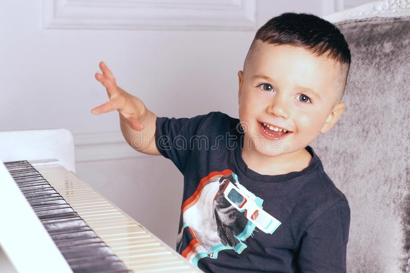 Boy playing the piano royalty free stock photos