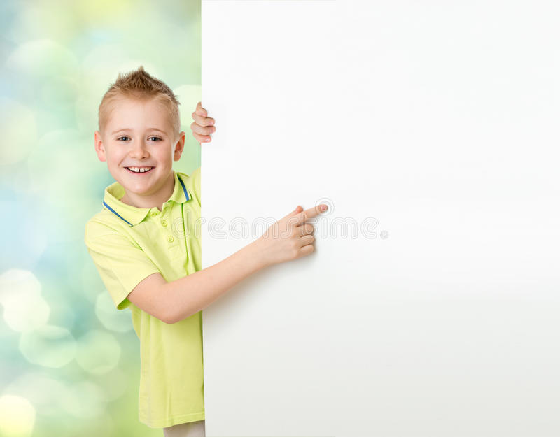 Handsome boy pointing to advertisement banner. Handsome boy pointing to blank advertisement banner stock photo