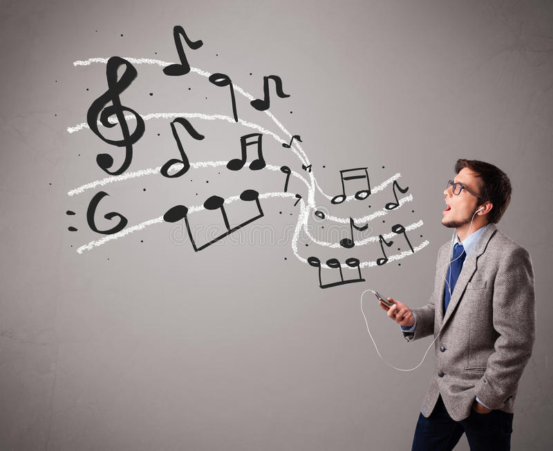 Download Handsome Boy Singing And Listening To Music With Musical Notes Stock Photo - Image: 28805228