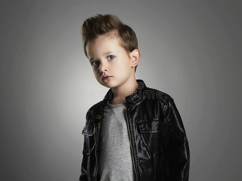 Handsome boy with trendy hairstyle.Fashionable child in leather coat. Funny little kid stock photos