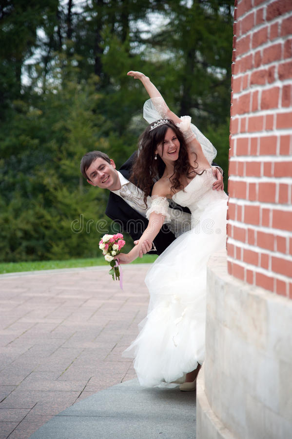 Handsome bride and funny groom stock image