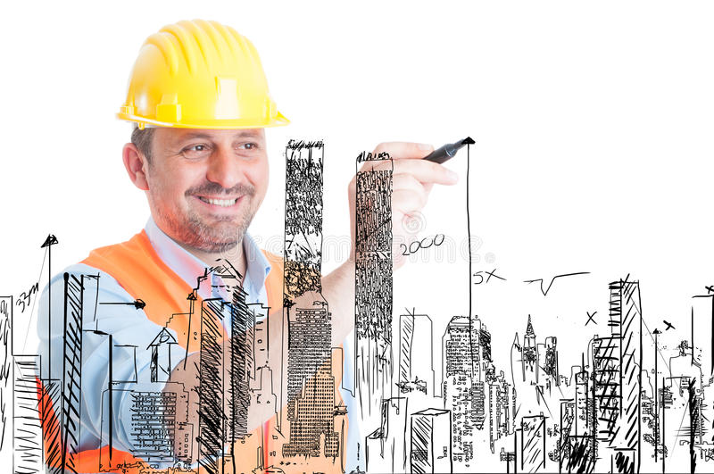 Handsome builder drawing buildings stock images