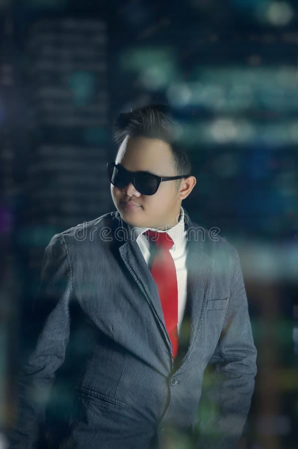 Handsome business man in formal attire. Looking elegant at night. royalty free stock photography