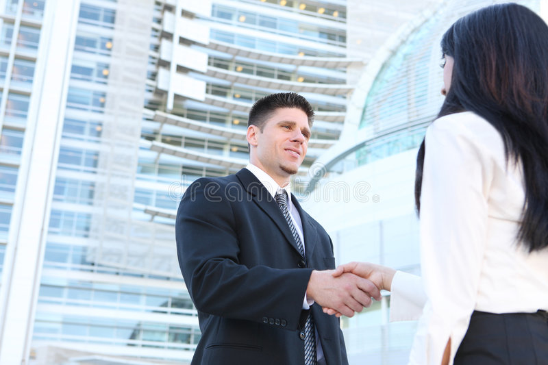Handsome Business Man Handshake royalty free stock photos