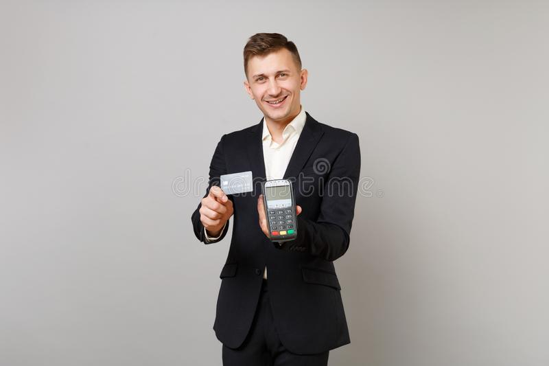 Handsome business man holding wireless modern bank payment terminal to process and acquire credit card payments black royalty free stock photo