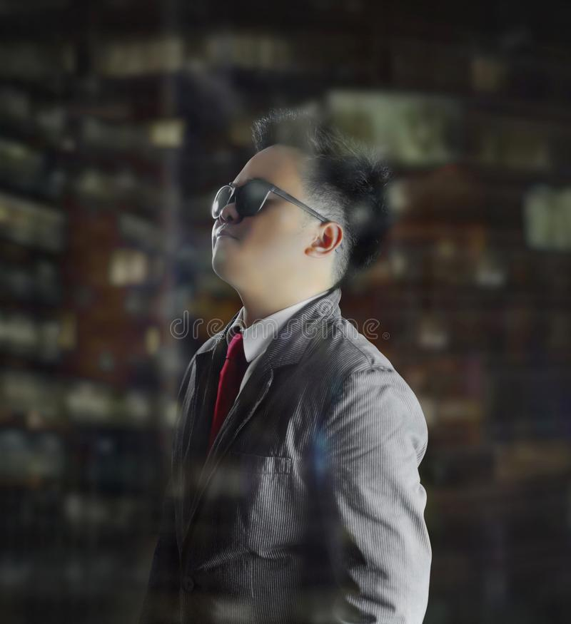 Handsome business man looking cool in side view, and looking up pose. royalty free stock images