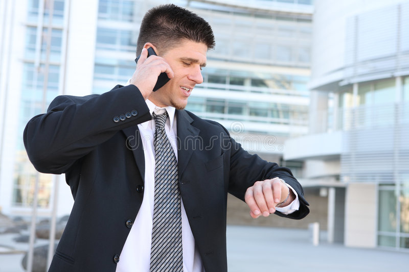 Handsome Business Man Looking at Watch stock images