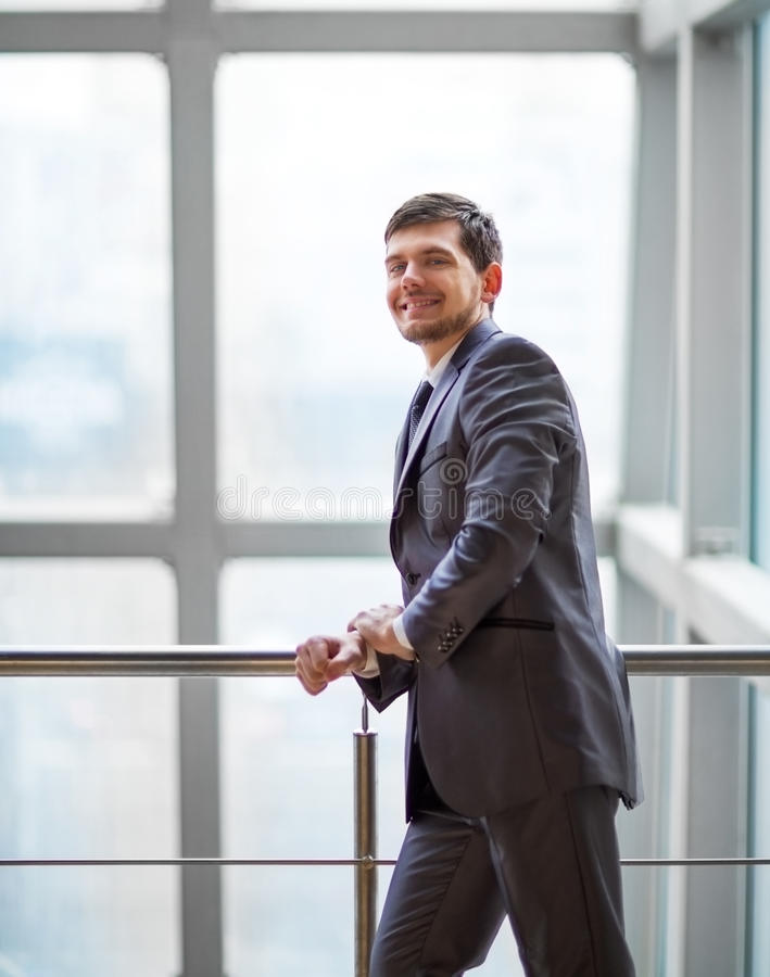 Handsome business man in the office. Portrait of a handsome business man in the office royalty free stock images