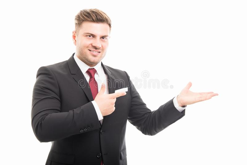 Handsome business man pointing copyspace area royalty free stock photo