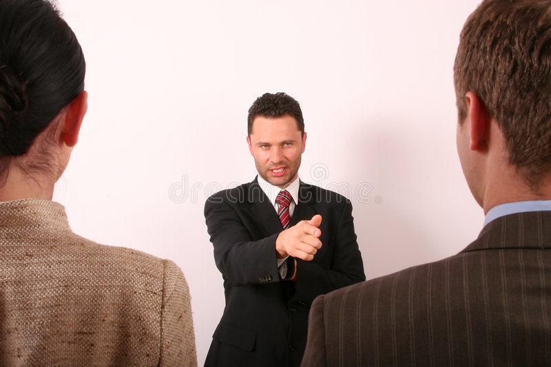 Handsome business man pointing at man 1 royalty free stock photo