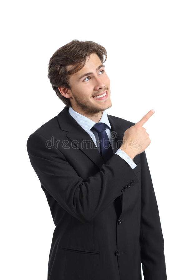 Handsome business man pointing at side presenting a product royalty free stock images