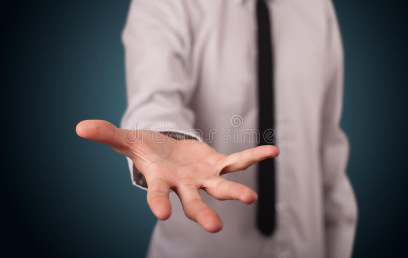 Handsome business man presenting with hand copy space. Handsome business man presenting with hand empty copy space stock images