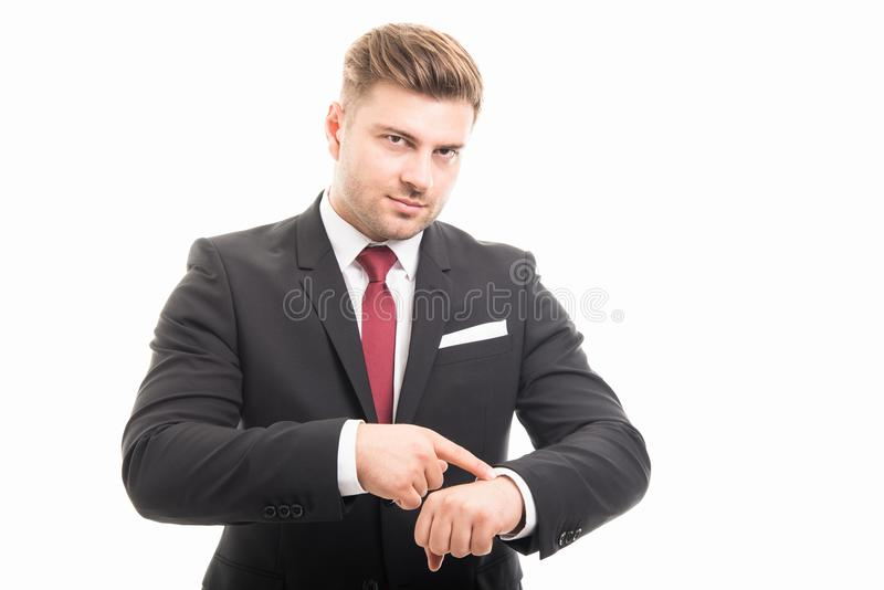 Handsome business man showing wrist watch. Like time out gesture isolated on white background royalty free stock images