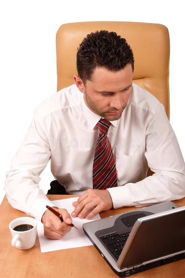 Handsome business man working in his office stock photography