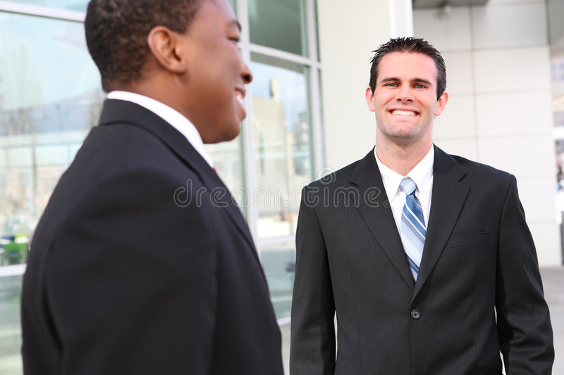 Handsome Business Men Team. Handsome, busy diverse business men at their company office building royalty free stock image