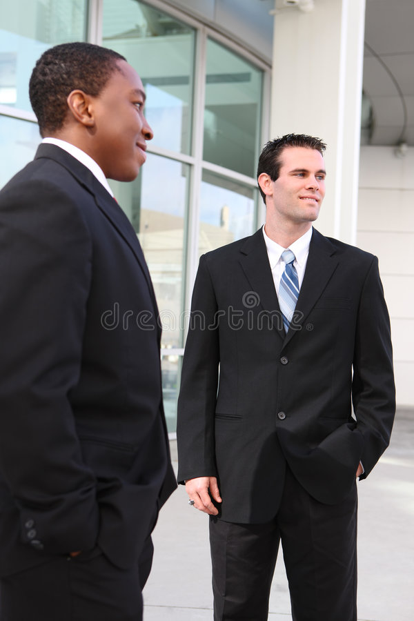 Handsome Business Men Team. Handsome, busy diverse business men at their company office building stock photos